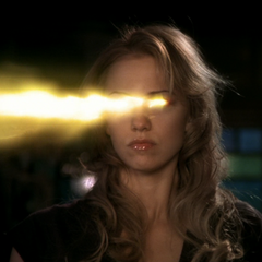 Christy shoots a fire bolt from her eyes.