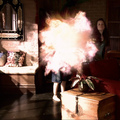 Christy heats the potion bottle from the inside, causing it to explode.