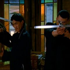 Two darklighters holding crossbows