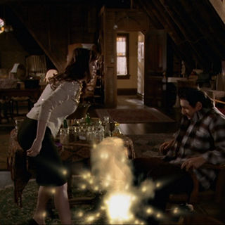 Paige throws the potion.