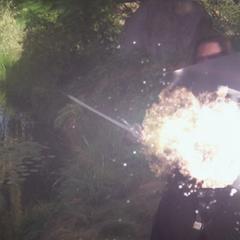 Piper blasts the Dark Knight, but his shield blocks her power.