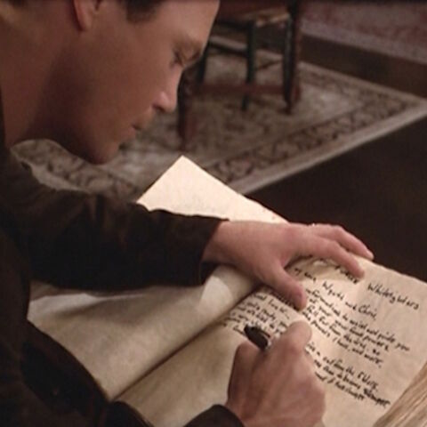 Leo writing the entry in the Book.