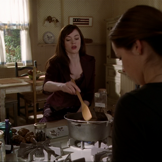Paige and Piper working on the potion.