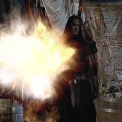 Piper blows up a Demon.