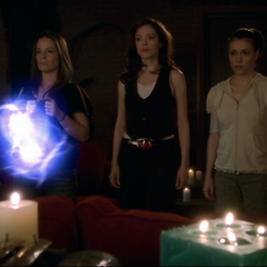 Zohar throws Energy Balls at the Charmed Ones.