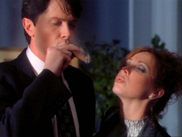 File:1x08-Hannah lights Rex's cigar.jpg