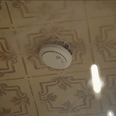 Piper blows up the smoke alarm in the kitchen.