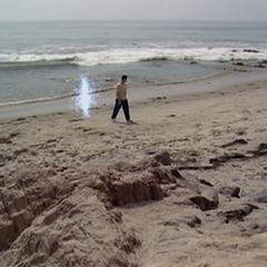 Paige orbs to Leo on the beach.