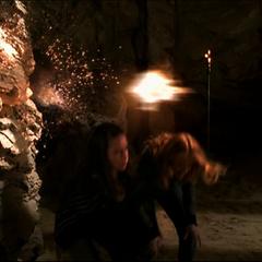 Piper and Paige dodge fireballs.