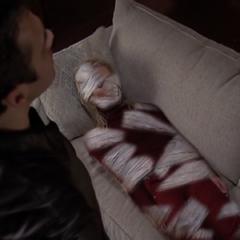 Jeric mummifies Sandra.