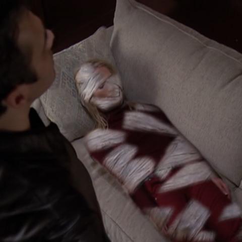 Jeric has cast the Spell to mummify Sandra.