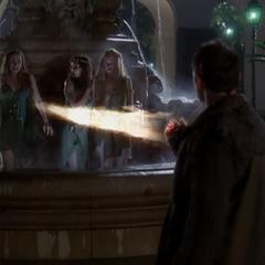 Xavier attacks the Nymphs, killing Lily.
