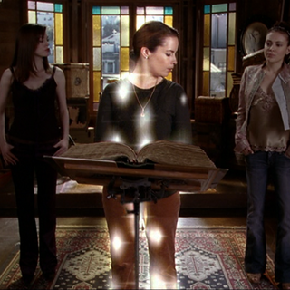 Piper is being called by shrunken Paige and Phoebe...