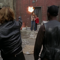 A Demon throws a fireball at Paige.