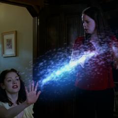 Paige deviates the Scabbar Demon's acid.
