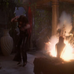 Leo blows up a vase in the Siren's lair, missing the Siren.