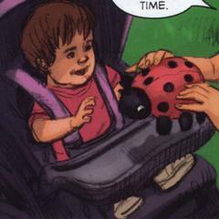 With a stuffed ladybug
