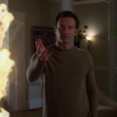 Cole using Pyrokinesis on Edward Miller.