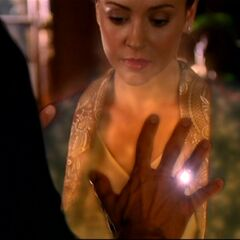 The ring showing what's surrounding Phoebe's heart.