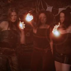 Pilar, Phoenix and Patra throw fireballs at the doll house.