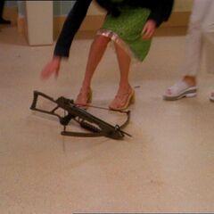 Alec drops his crossbow.