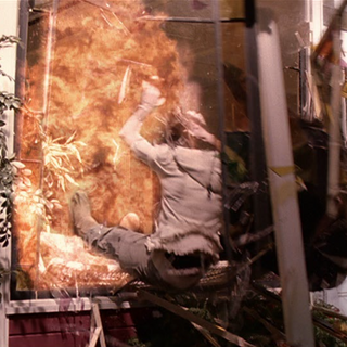 The Charmed Ones are thrown through the conservatory wall by the blast.
