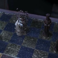 Gideon telekinetically moves a chess piece.