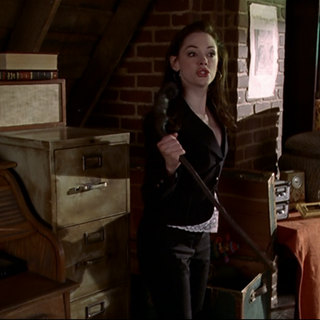 Paige holding a Shillelagh.