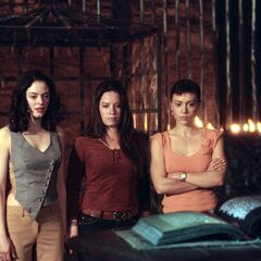 The Charmed Ones in front of the Grimoire