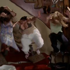 The Charmed Ones are thrown back by a force blast.