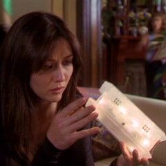 Prue holding the box.