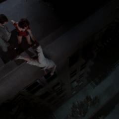 Phoebe holding Edward Miller upside down, using Super Strength.