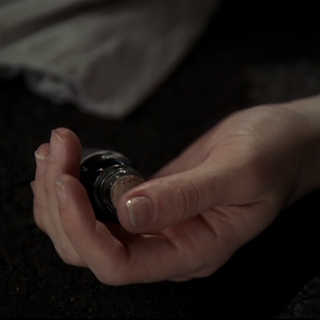 The potion bottle in Paige's hand.