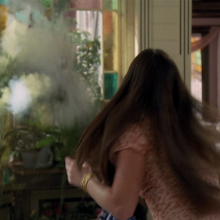 Piper shocked as she blows something up.