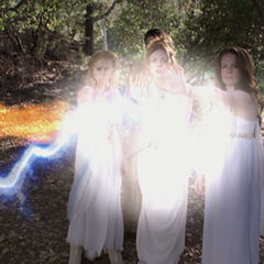 The sisters create Force Field to protect themselves and Roland.