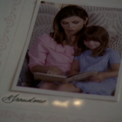 Patty projects a note in Piper's baby book.