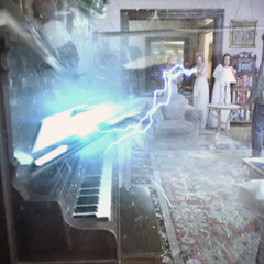 Paige (as Goddess of War) destroys a piano.