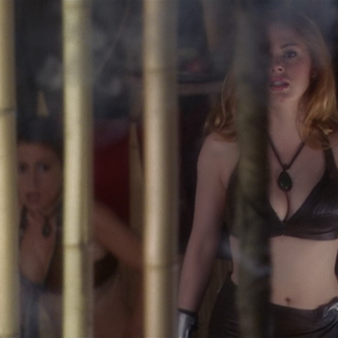 Paige opens the door of the cage with a potion.