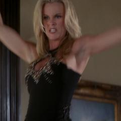 Mitzy levitates to kick Phoebe.