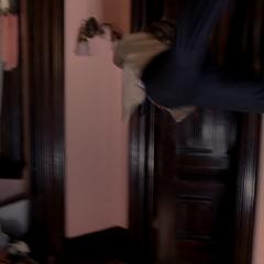 Leo flings Inspector Sheridan against a wall.