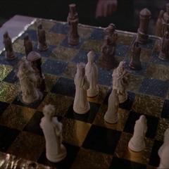 Parallel Gideon telekinetically moves a chess piece.