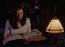 Prue studying the book
