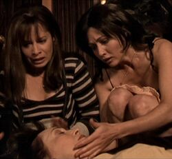Prue and Piper over Penny's body