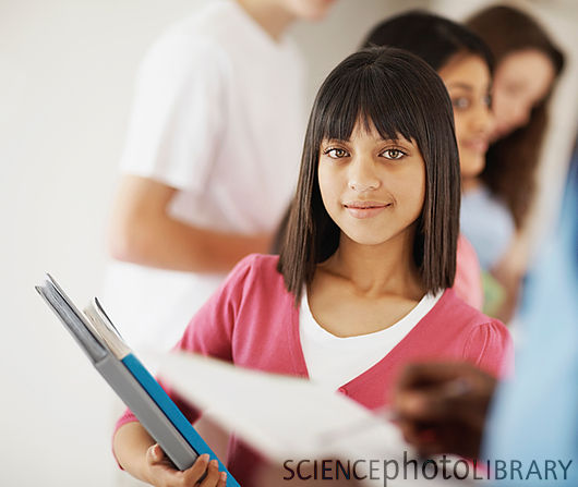 File:F0039823-Girl with books, students at the back-SPL.jpg