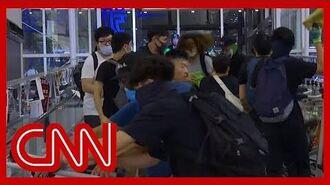 Chaos erupts at Hong Kong airport as riot police take on protesters