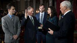 Doug Jones taking an oath