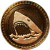 100px-64px-Uncharted 3 trophy Land Shark