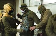 Chernobyl-25th-anniversary-liquidators-firefighters-suiting-up 35077 600x450