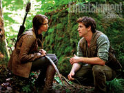 Katniss and Gale in the woods