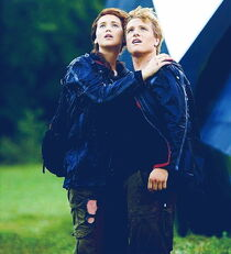 Winners Katniss and Peeta wait for a hovercraft to pull them up